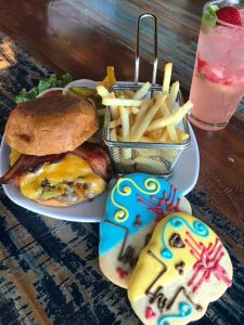 Enjoy a delicious green chile chees burger at Cinnamon Cafe Nob Hill